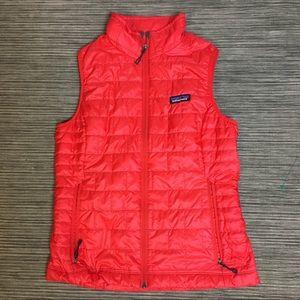 Patagonia puffer nano vest in a red orange